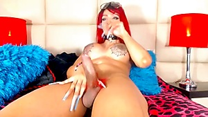 Red Haired Tranny With Extremely Long Nails